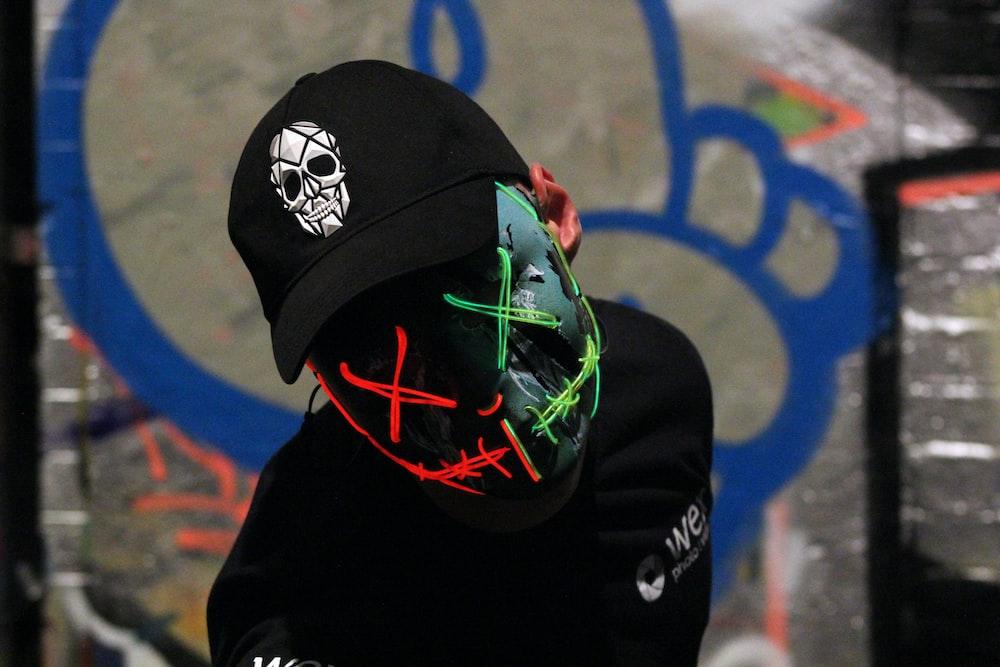 man in black cap and black top