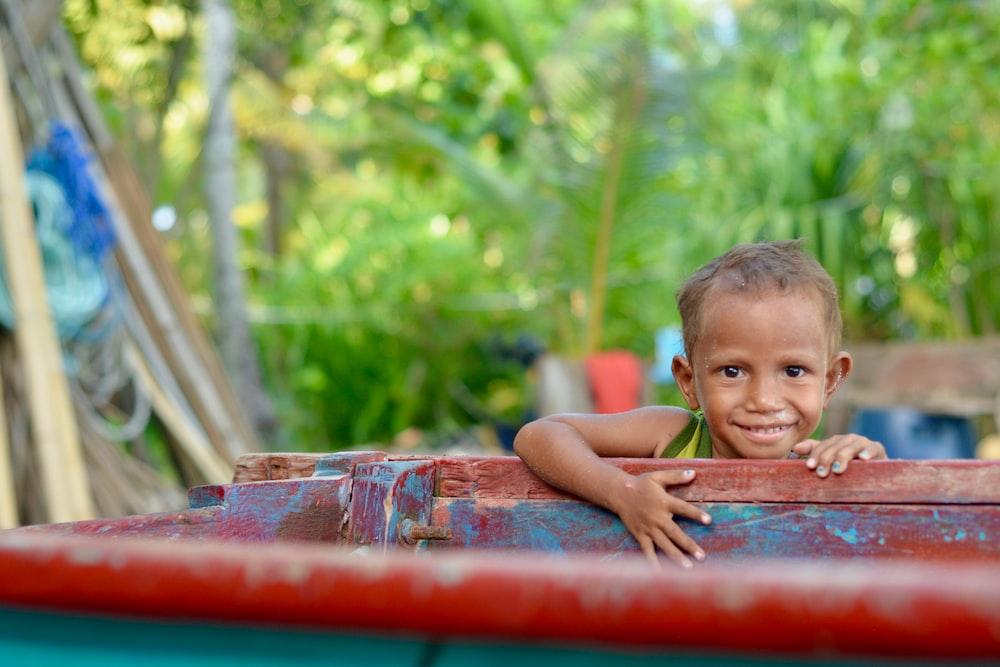 smiling boy near the wood