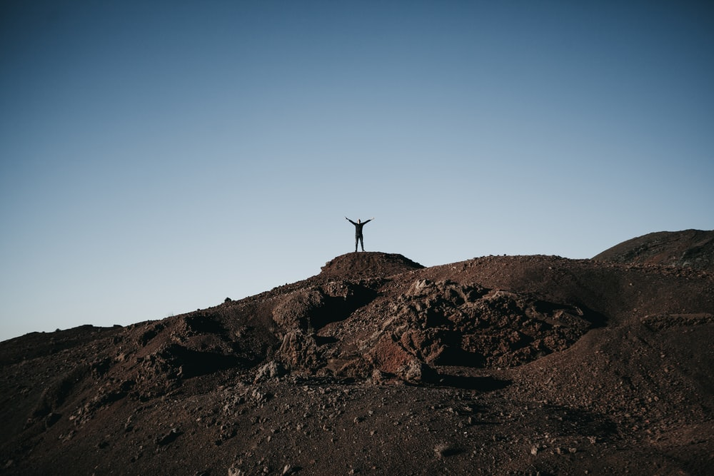 person standing on top of hill