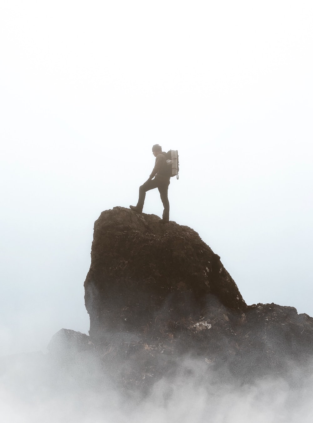 silhouette photography person standing on rock formation