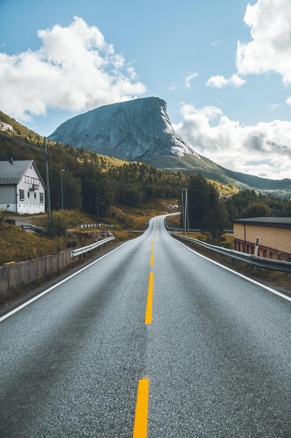 black asphalt road under clear blue sky