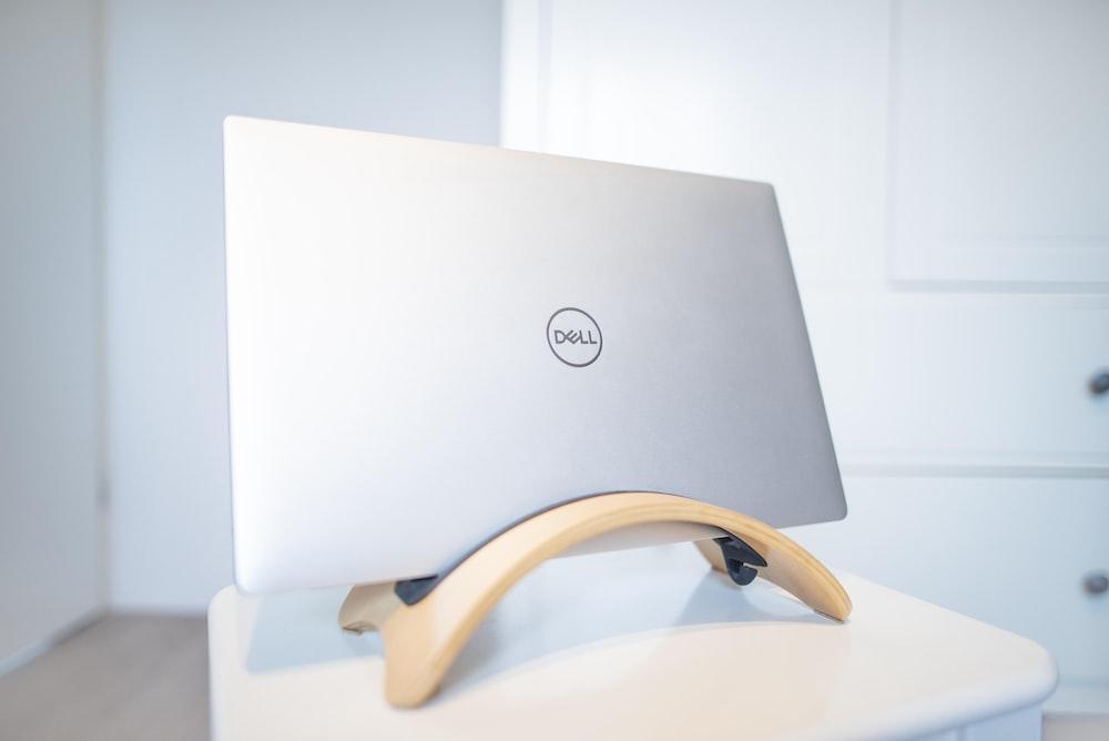 grey Dell laptop computer