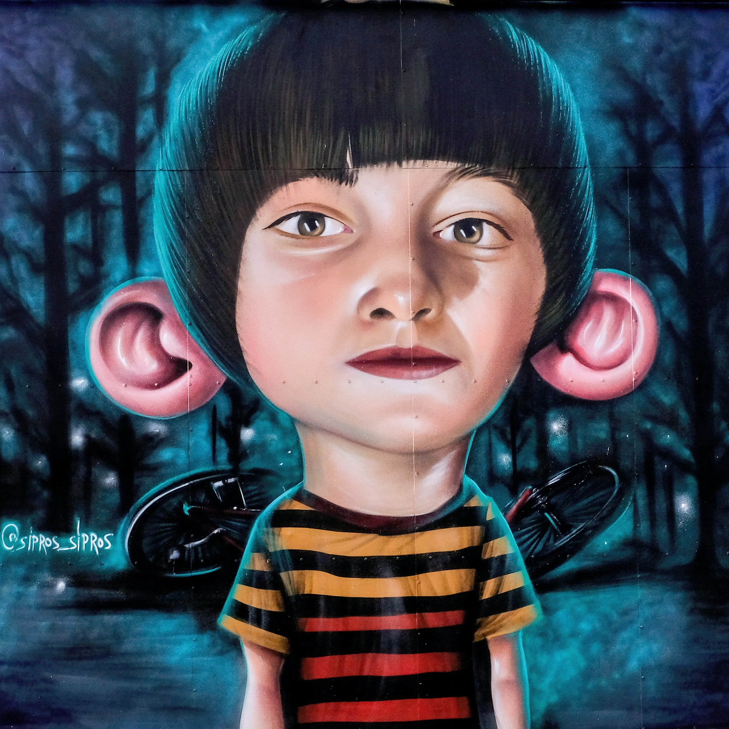 boy with big ears painting