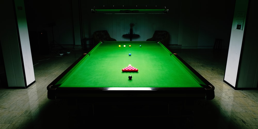 green and brown pool table