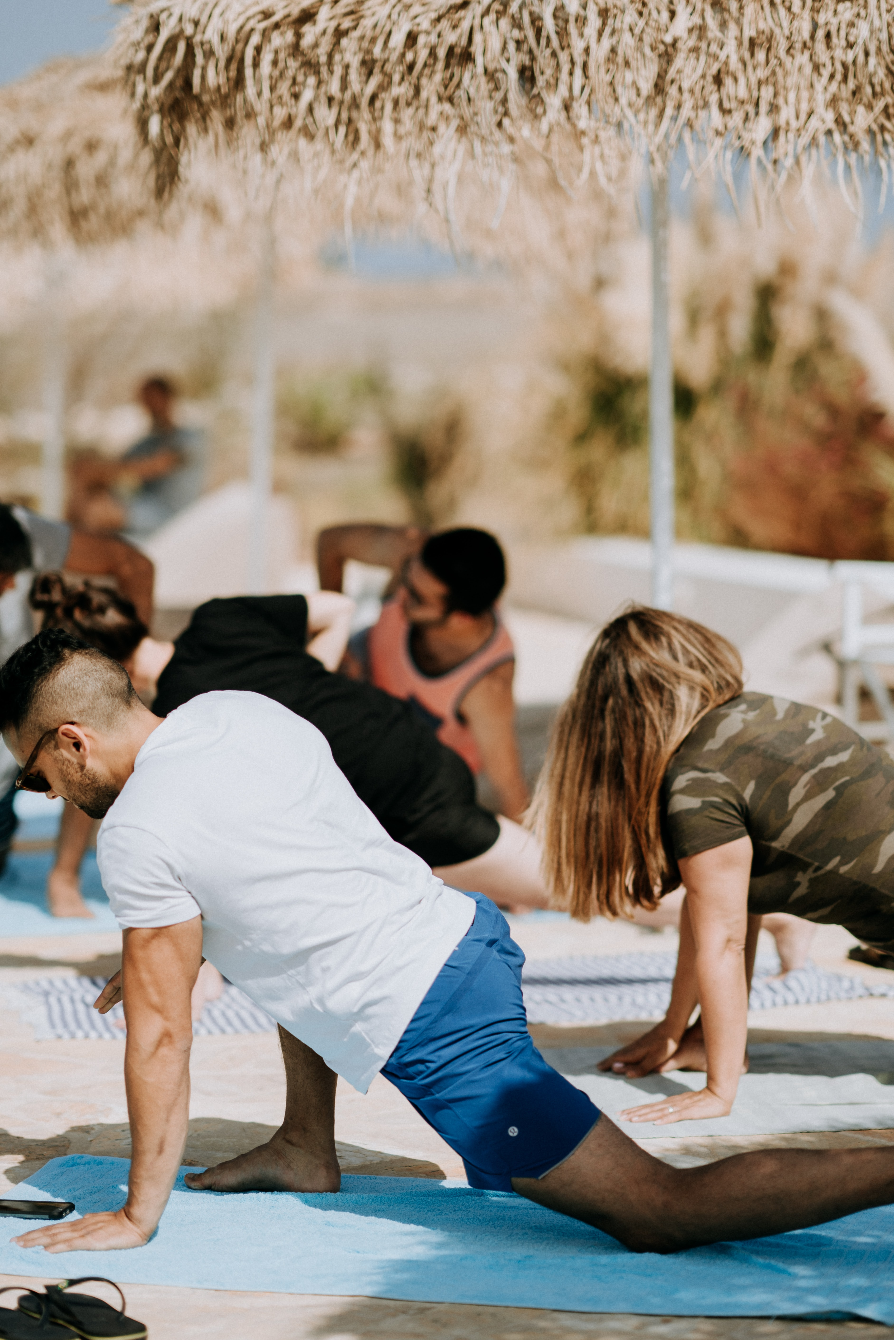 people stretching their bodies during daytime