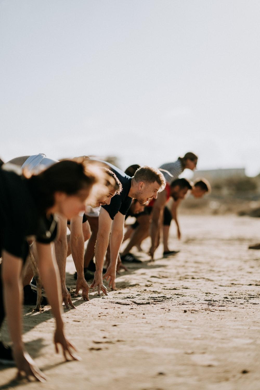 men preparing for running race