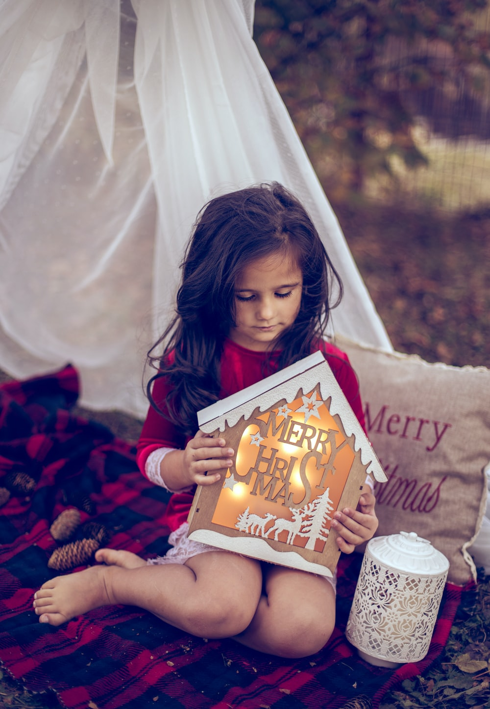 girl sitting holding lightened decor