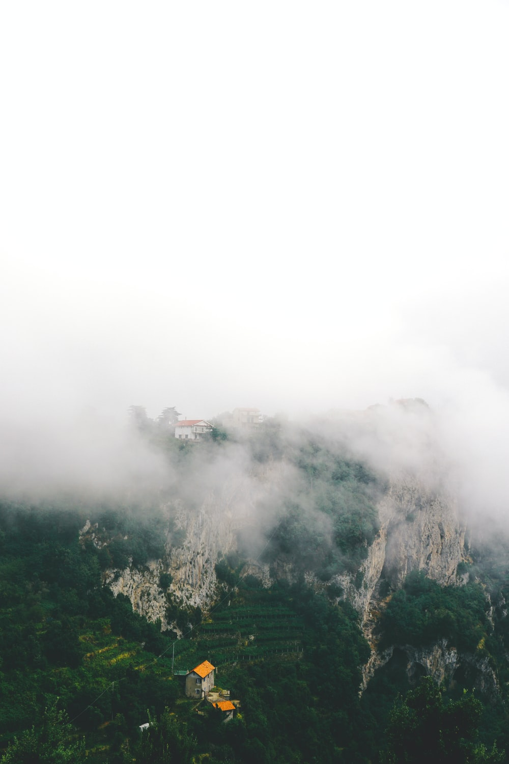mountain with fog above