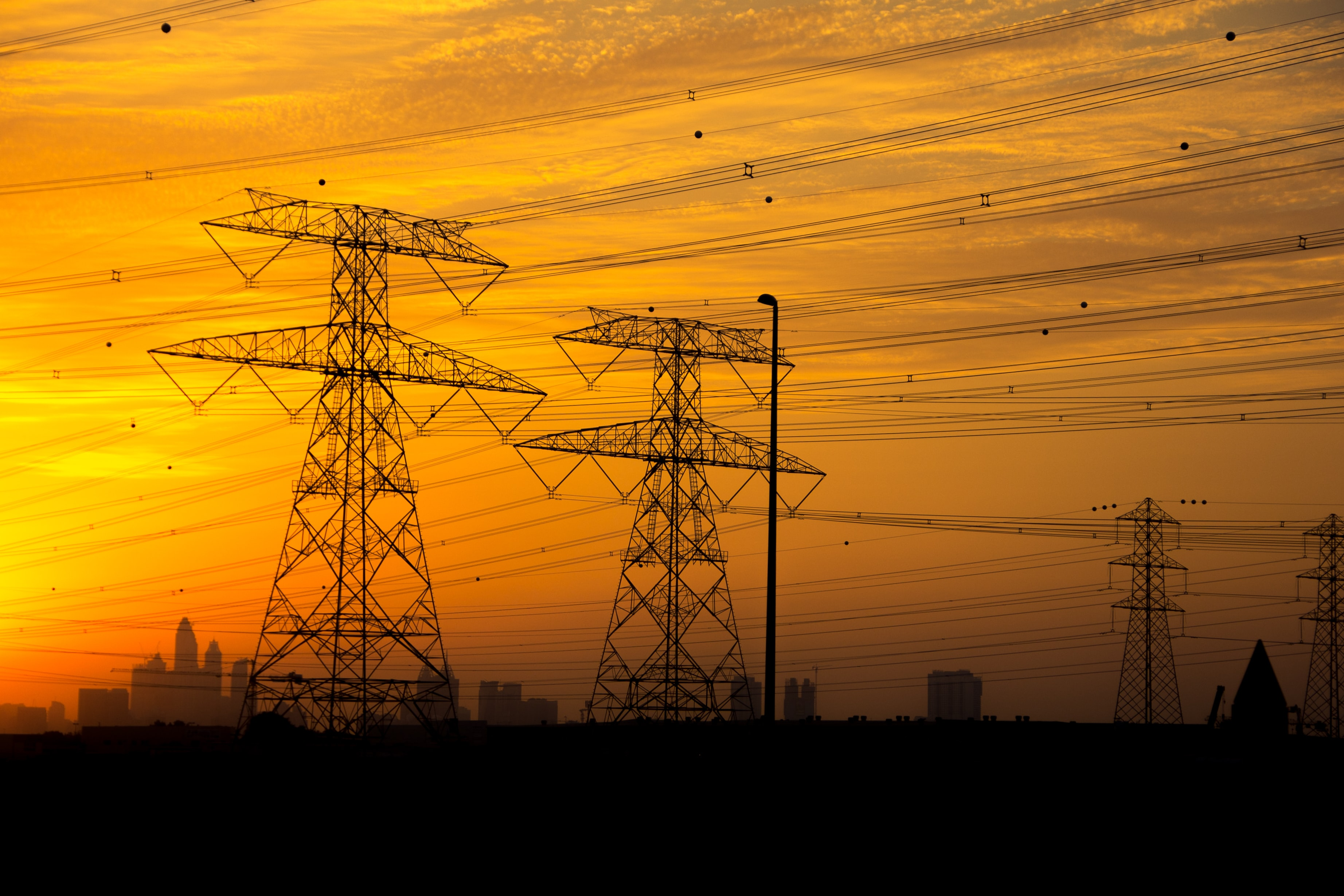 several transmission towers during golden hour