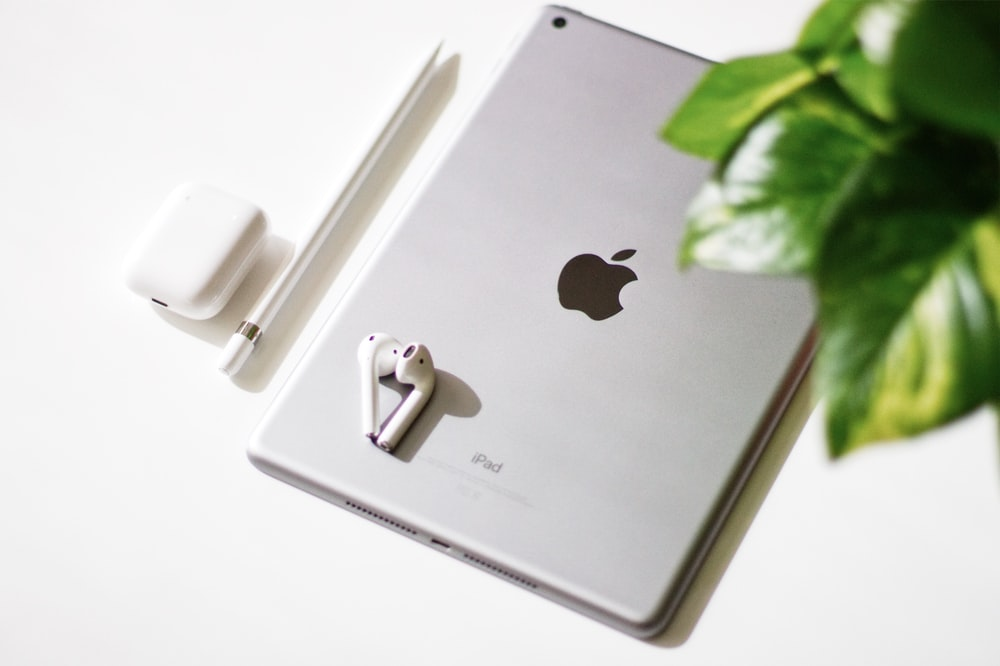 silver iPad and Apple AirPods