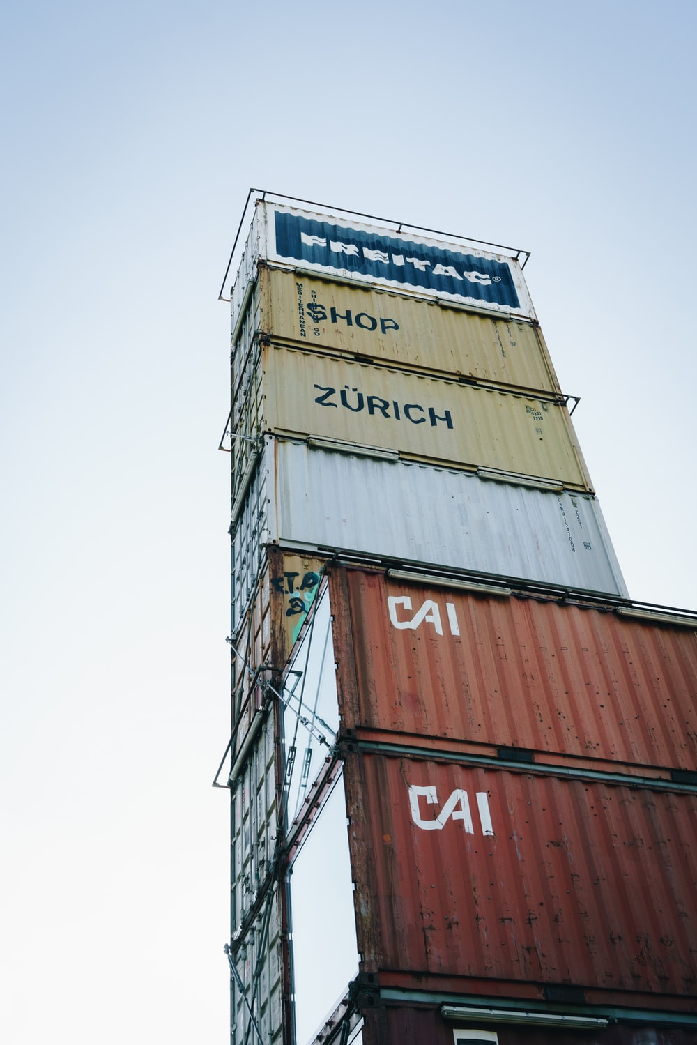 low angle photography of pile of intermodal containers
