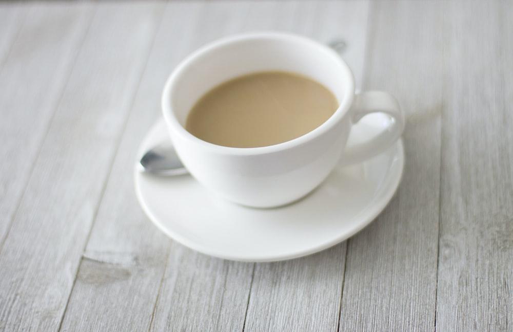 white teacup on saucer