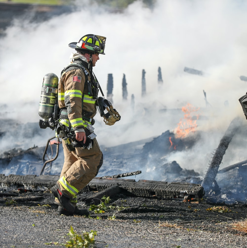firefighter watching of burning plank