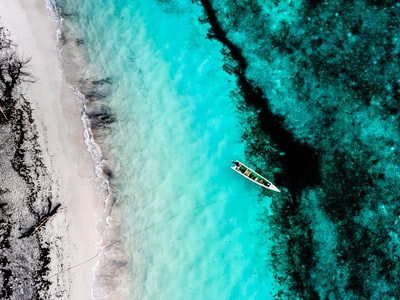 aerial photography of boat on sea timor-leste zoom background