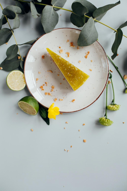 sliced fruit on round white ceramic plate