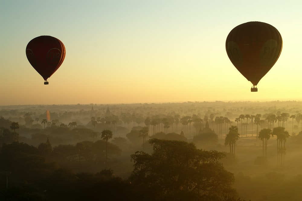 two hot air balloons on sky