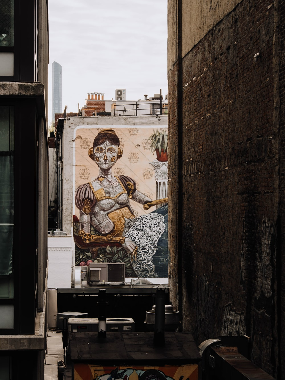 man in brown dress painting