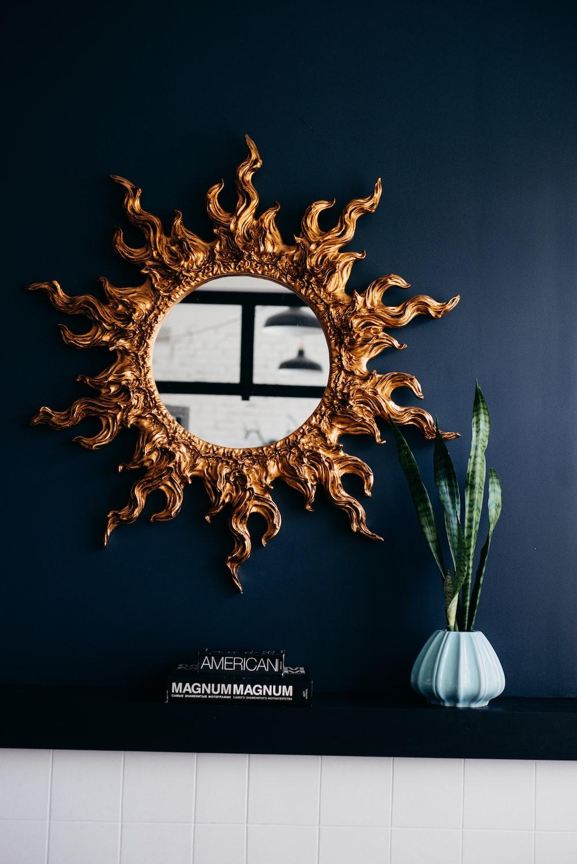 gold sun burst mirror