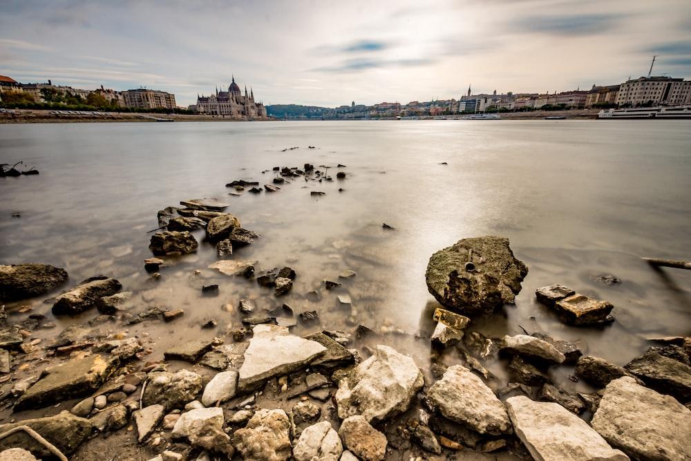 stack of rocks near body of water