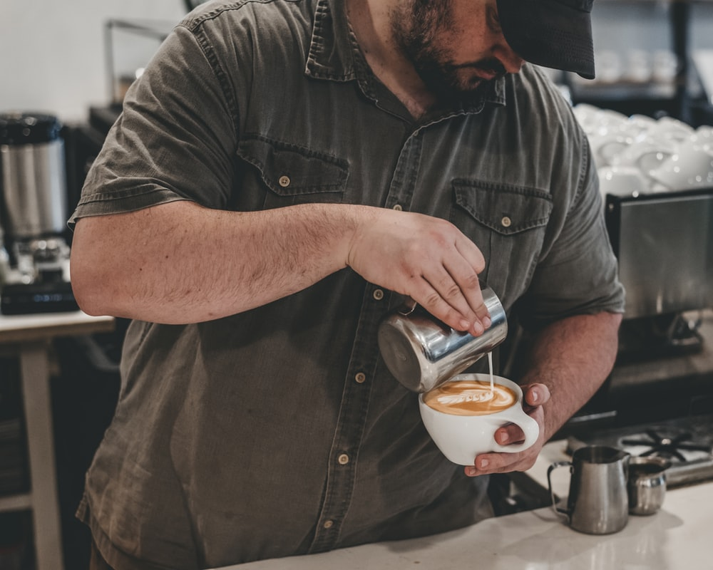 man preparing an espresso
