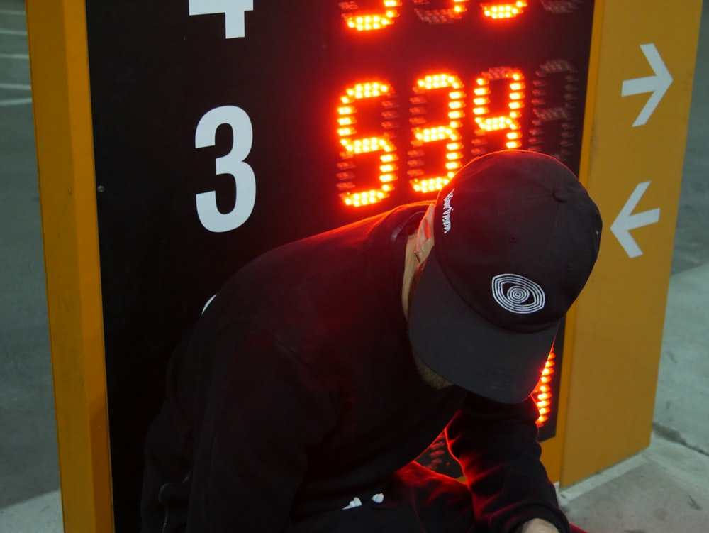 man sitting beside digital signage