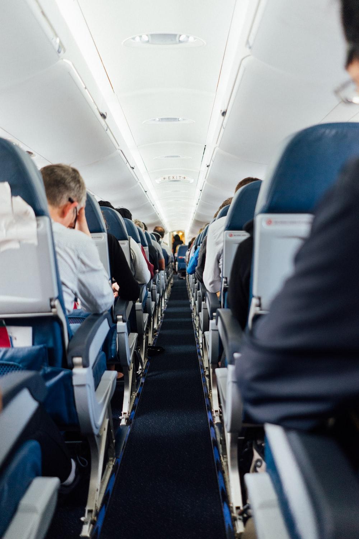 people sitting inside plane