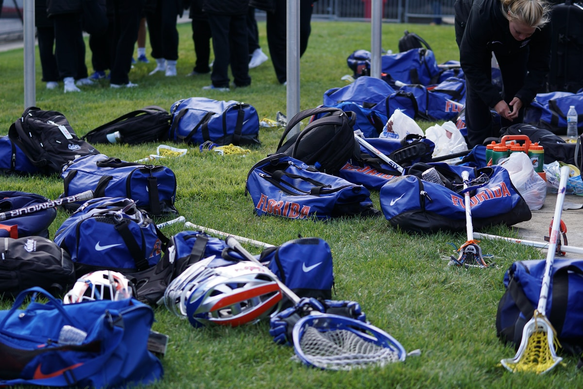 Lacrosse equipment laying on the grass