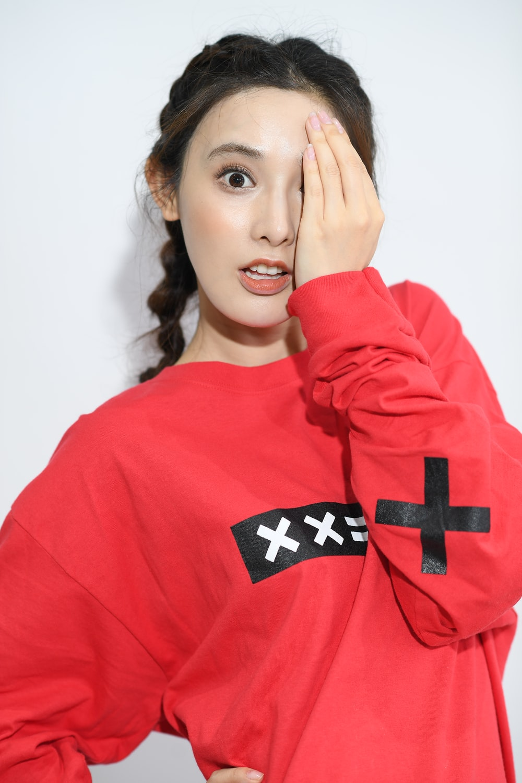 woman wearing red and black sweatshirt