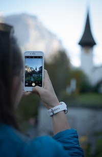 selective focus photography of woman holding smartphone