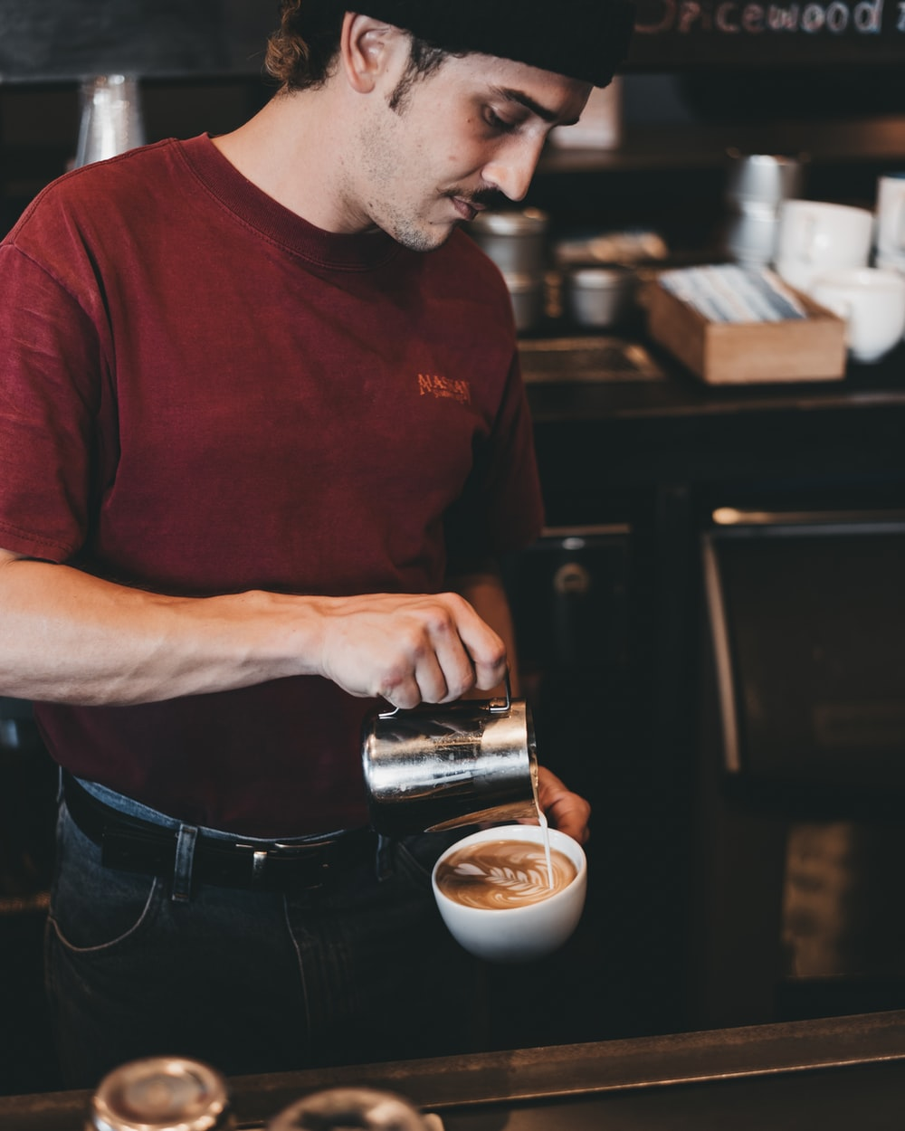 man holding teacup