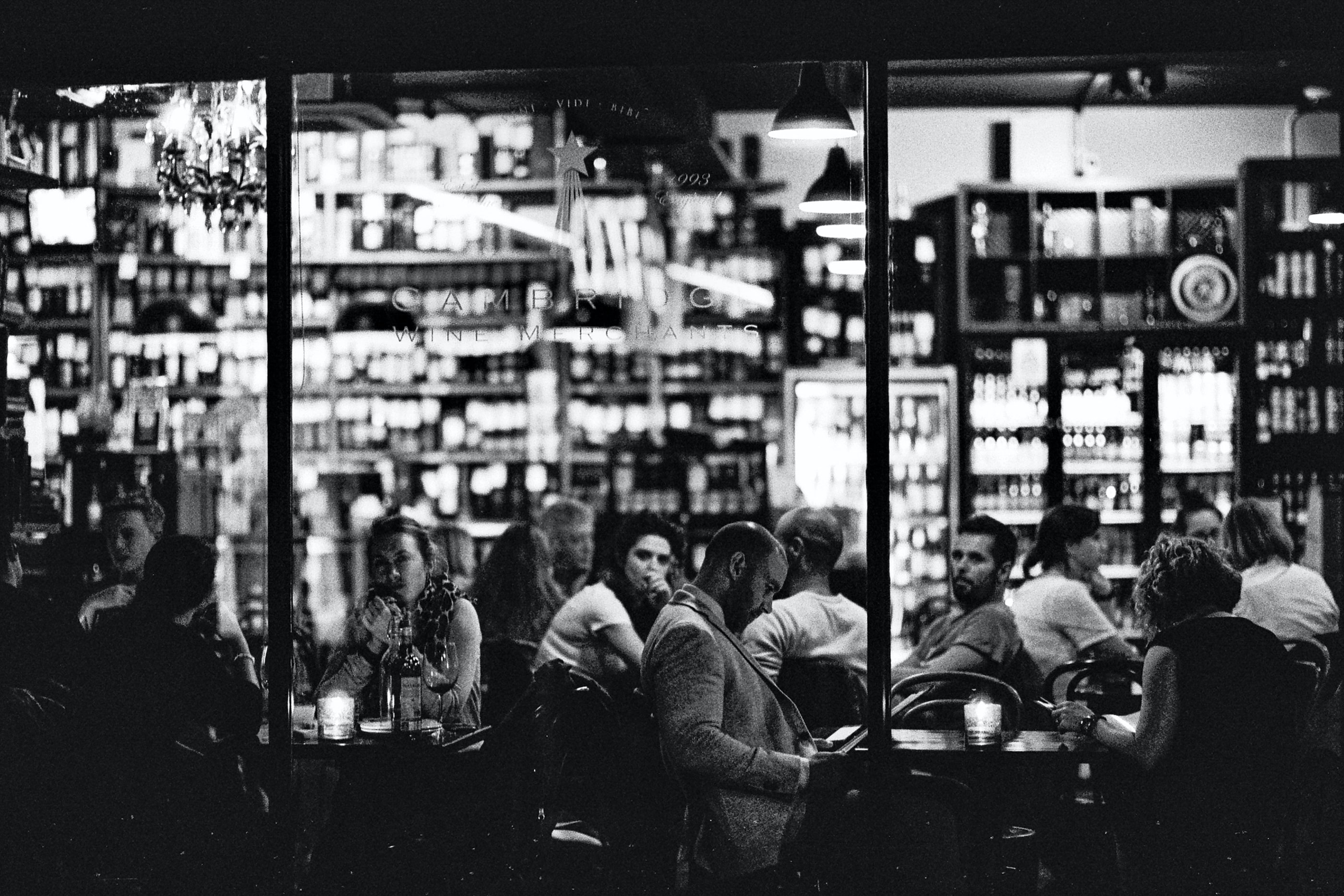 grayscale photography of people outside store