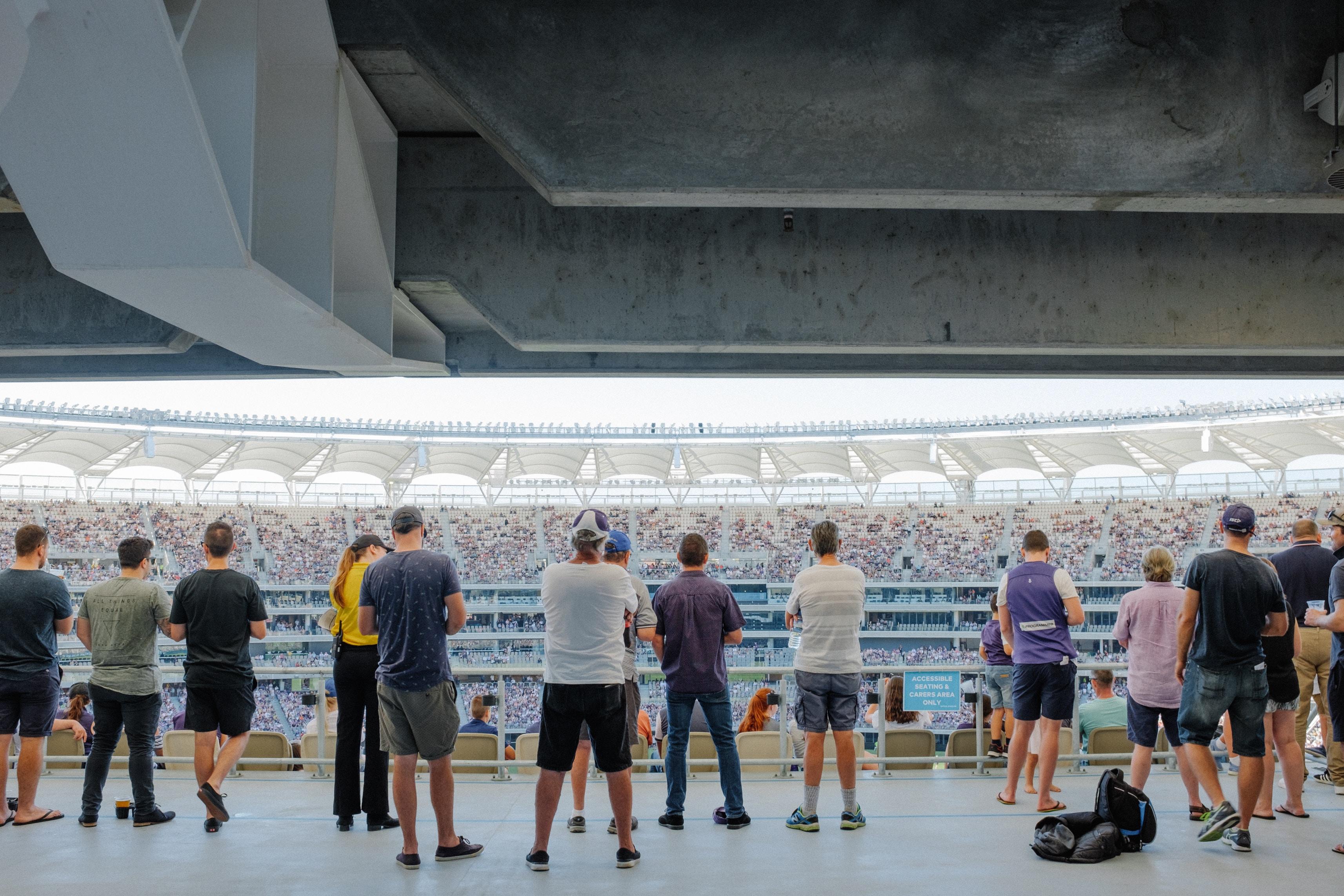people standing on stadium