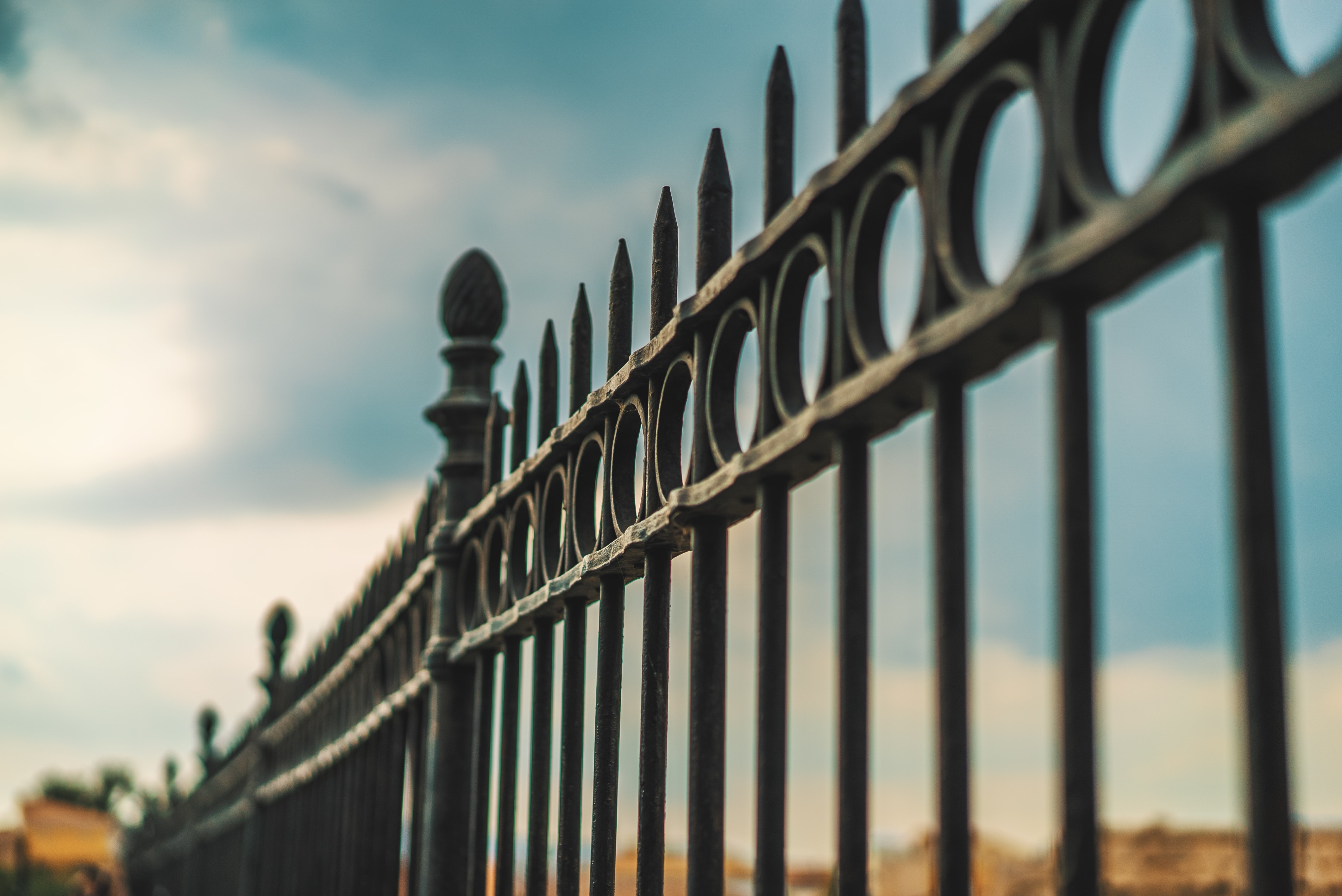 focus photography of black metal gate