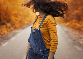 woman wearing blue overalls