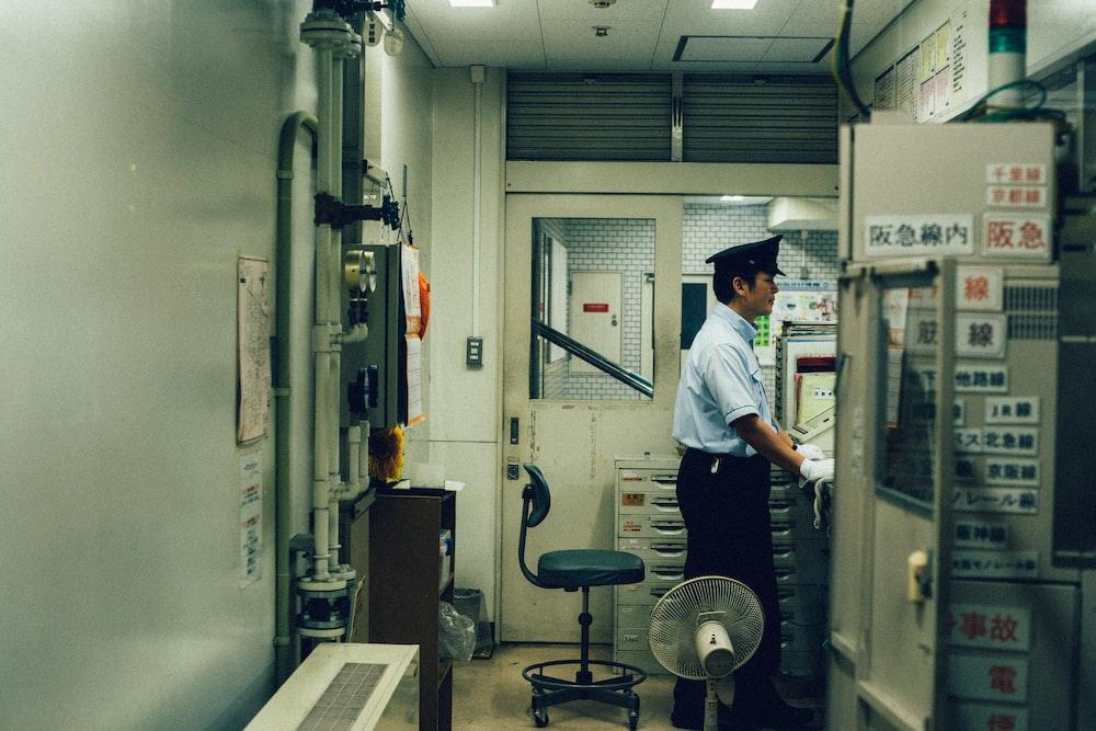 man standing near the control panel