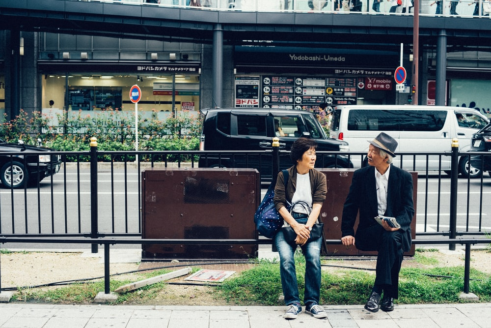 woman and man sitting on bench