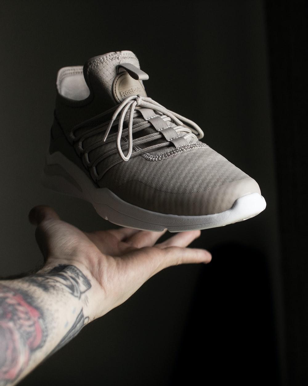 unpaired brown running shoe