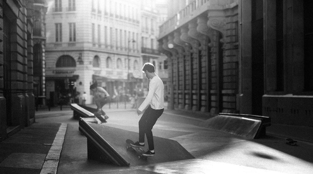grayscale photography of man skateboarding