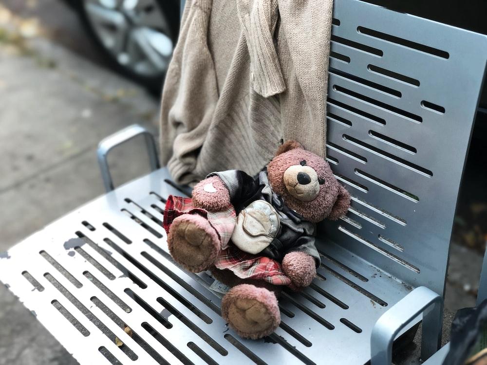 brown teddy bear on chair