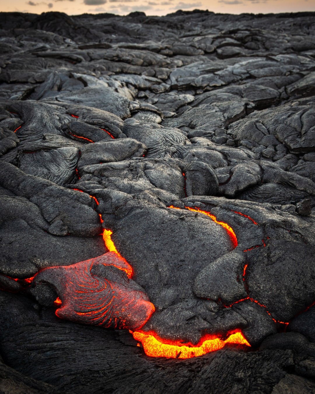 This was one of the most amazing things I've ever seen, and something everyone should try to see at least once. Seeing a lava flow up close is just so intense(literally, from the heat) and awe inspiring. My two oldest sons and I had decided to bike out to see the lava flows on Hawaii's big island last year along with the lava hose going into the ocean. The lava hose flow had slowed down quite a bit and from the distance they had roped off, you could mostly just see steam. We decided to hike into the lava field to the north, in hopes of finding some of the smaller magma flows on the surface.