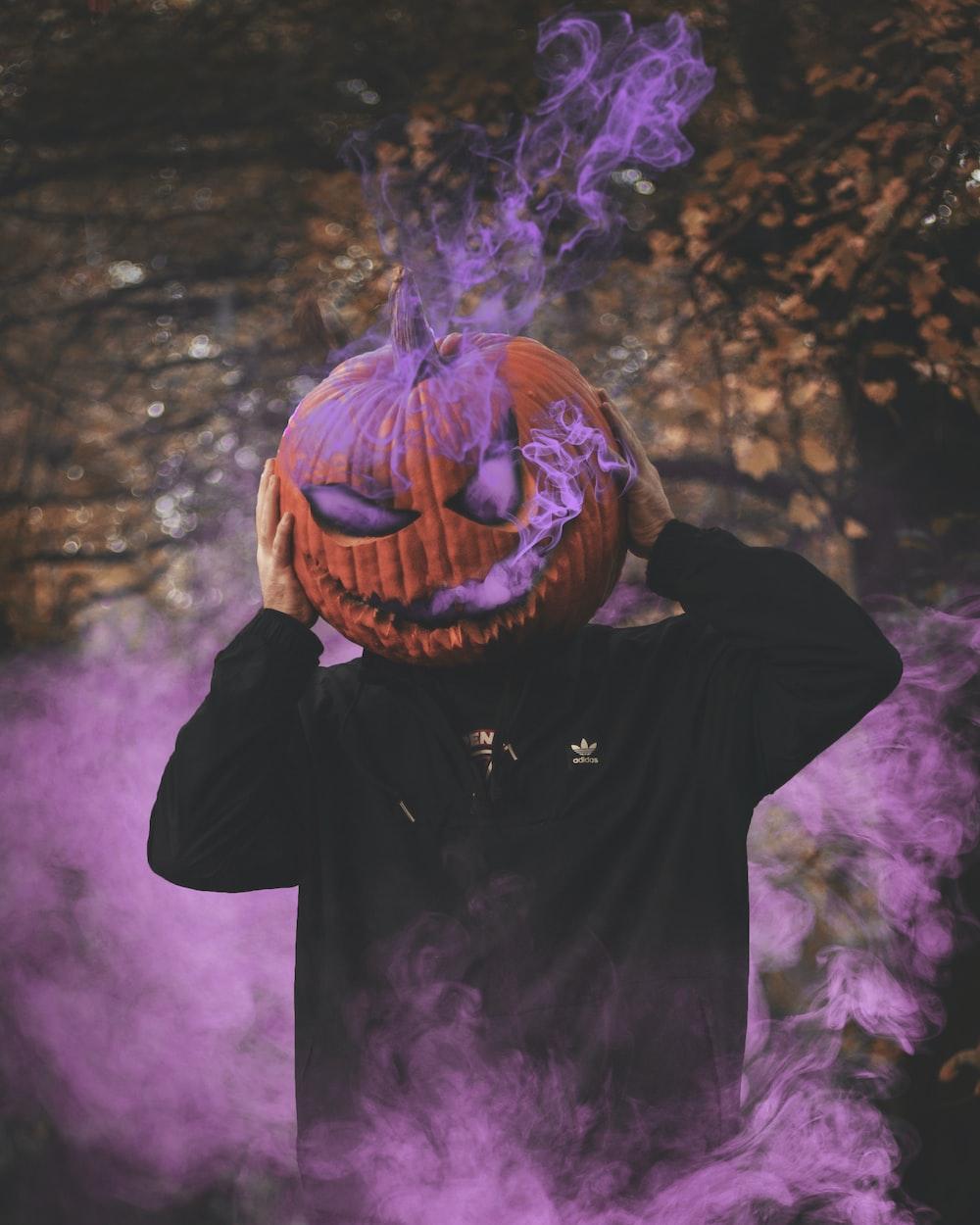 man wearing jack-o-lantern