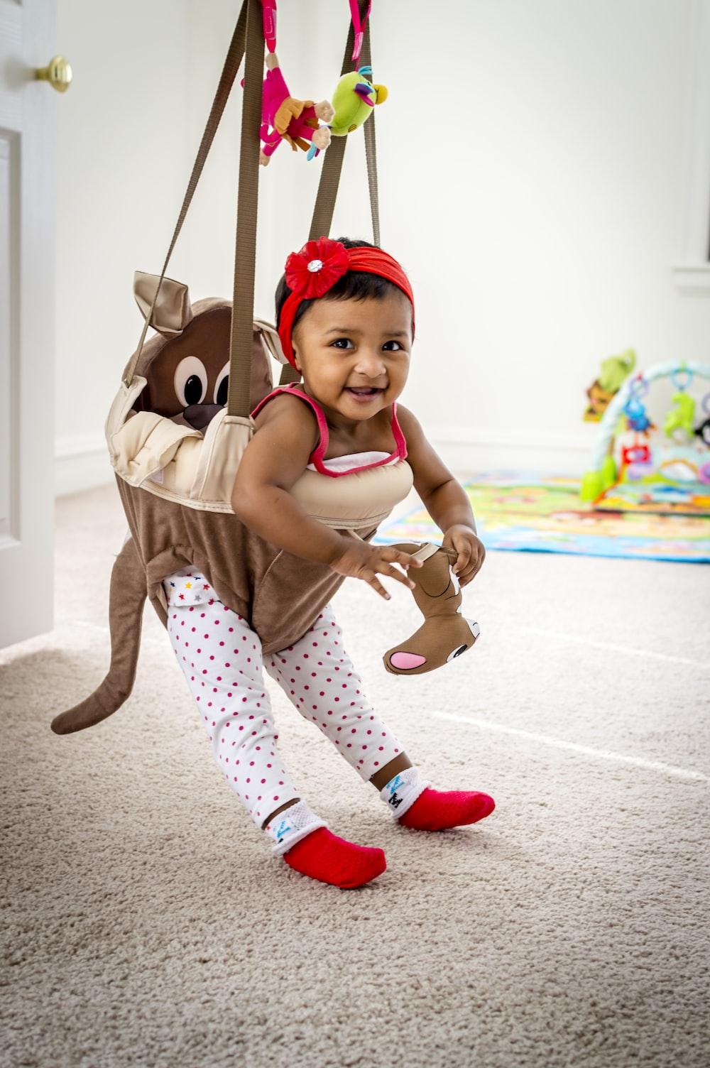 girl on hanging jumper smiling