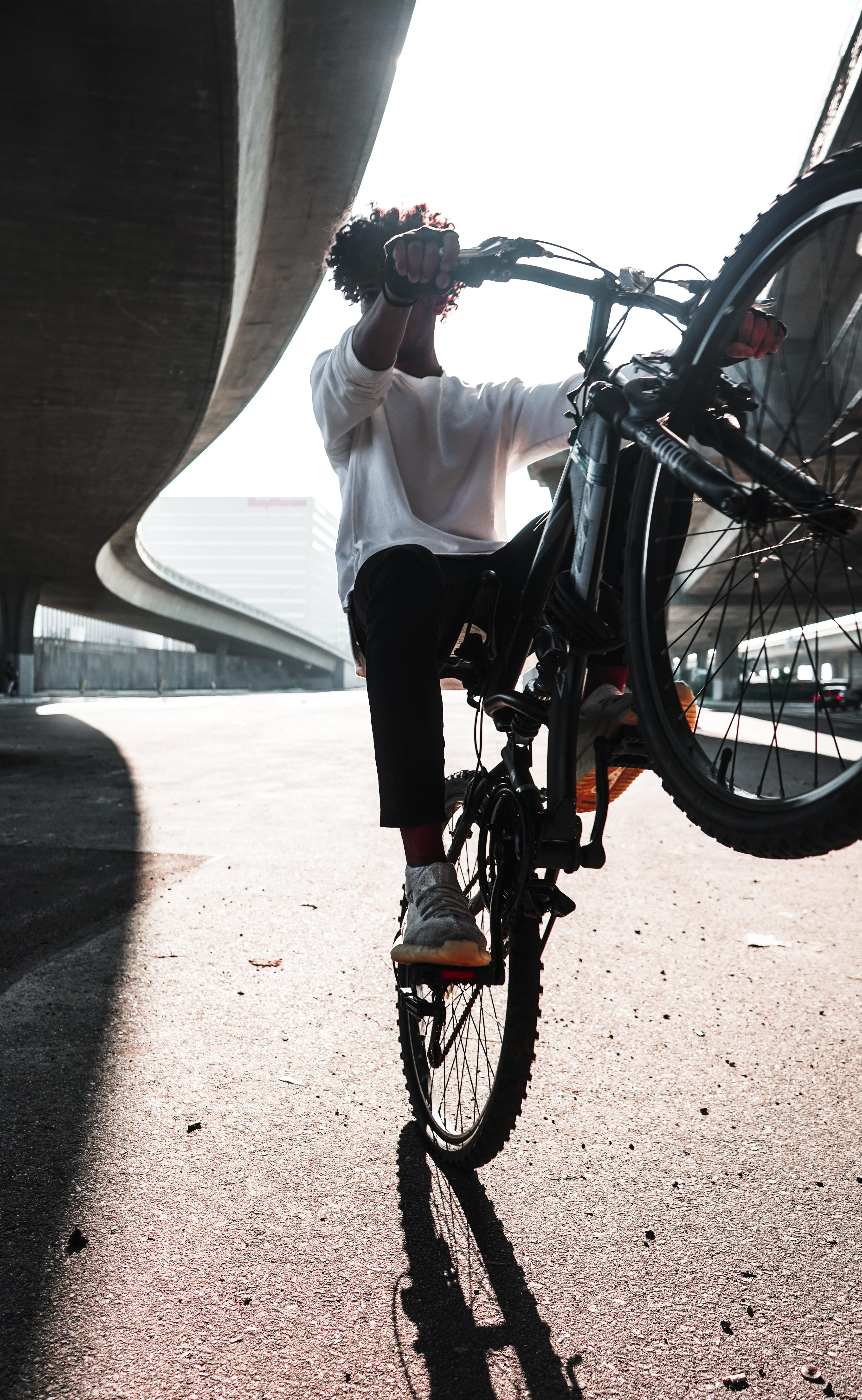 man riding hardtail bike during daytime