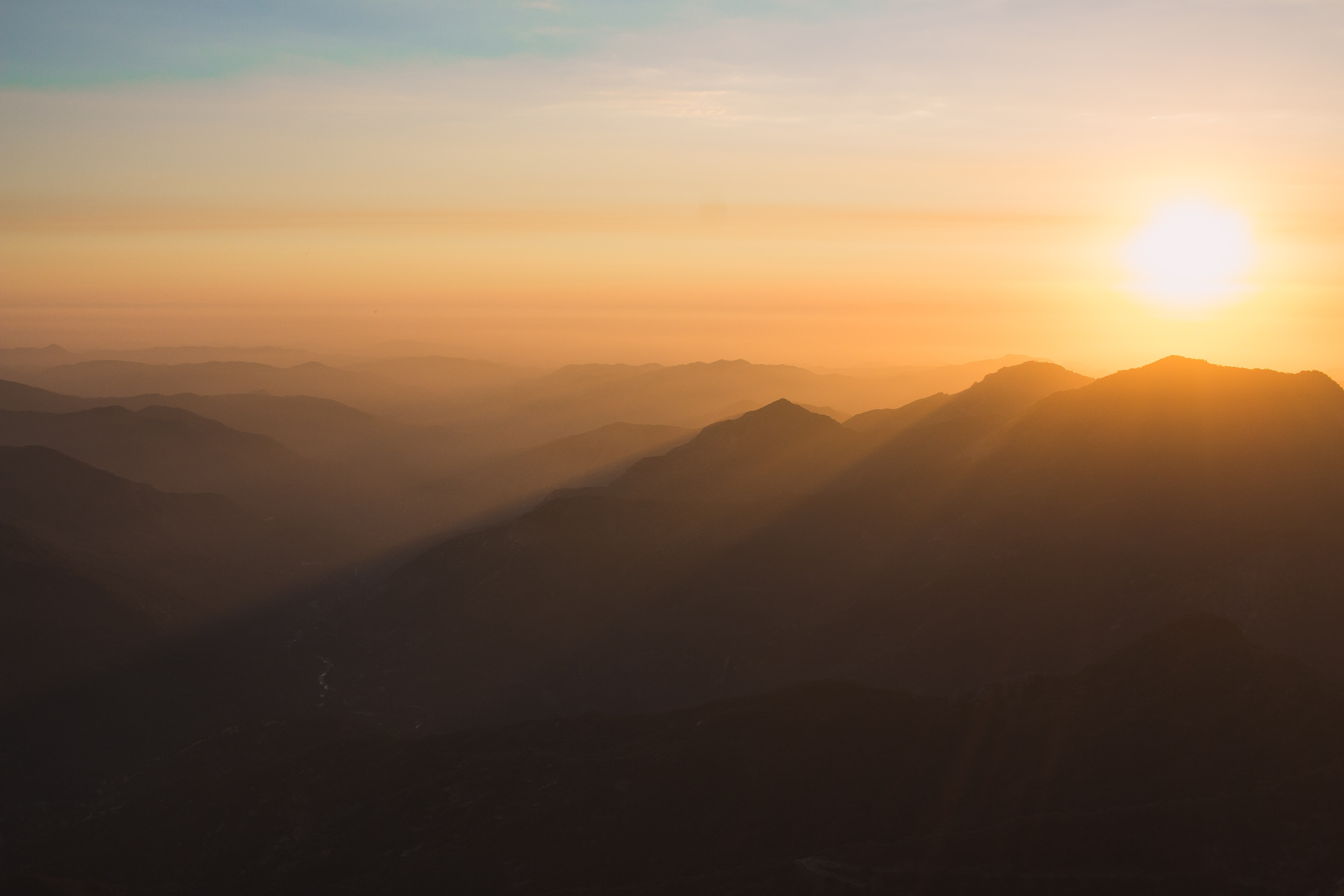 landscape photography of mountains during sunset