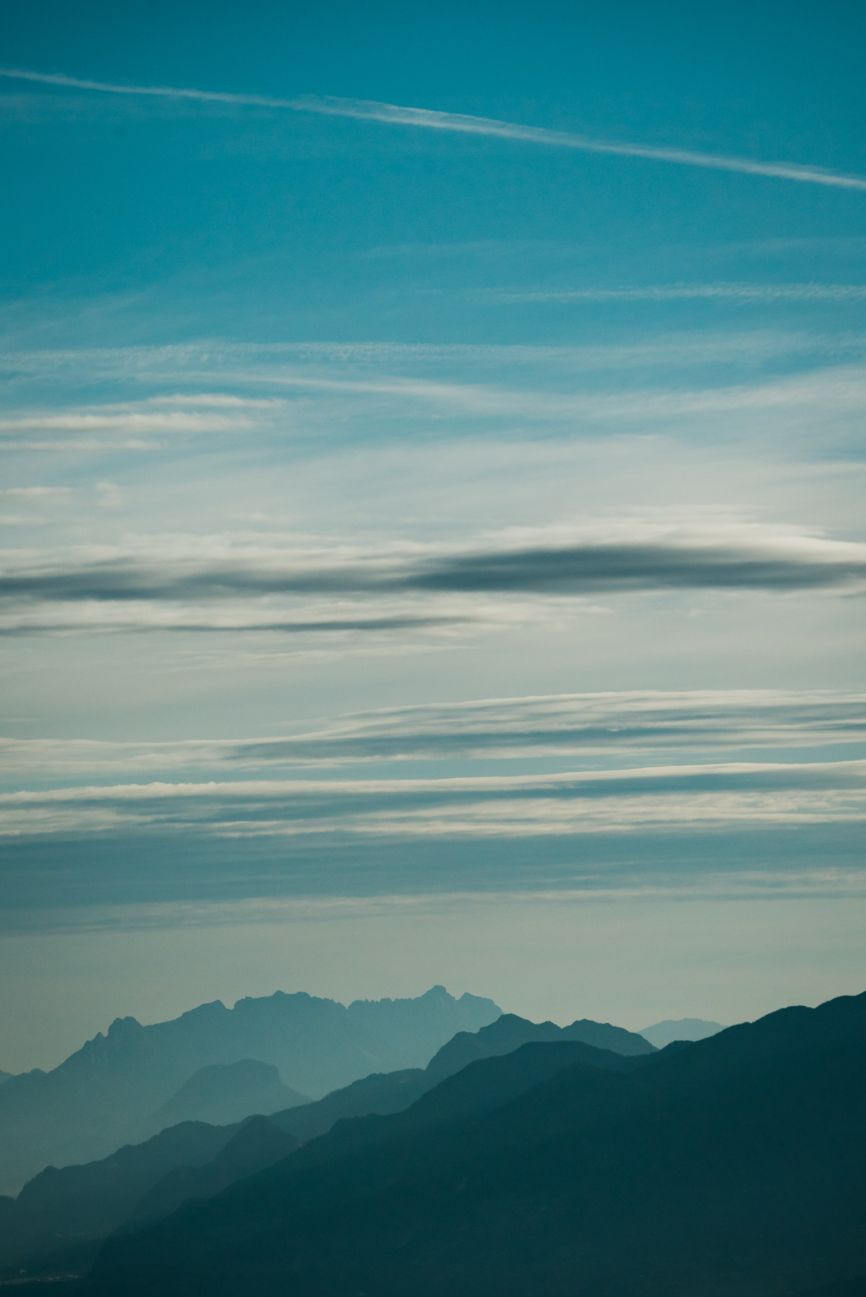 high-angle photography of mountain peak and clouds