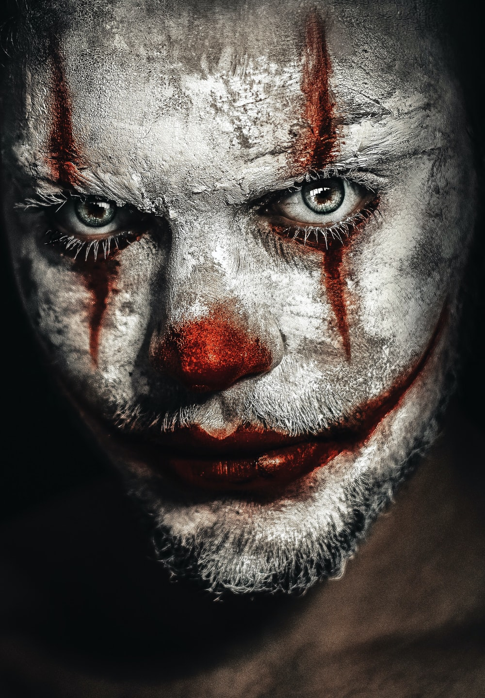 man with clown face painting