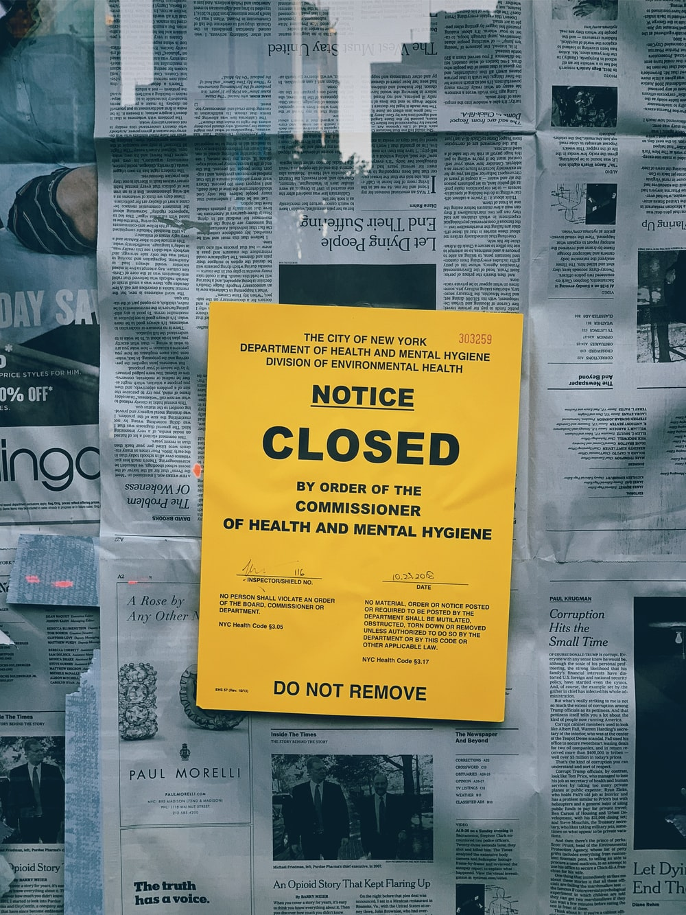 yellow notice closed signage