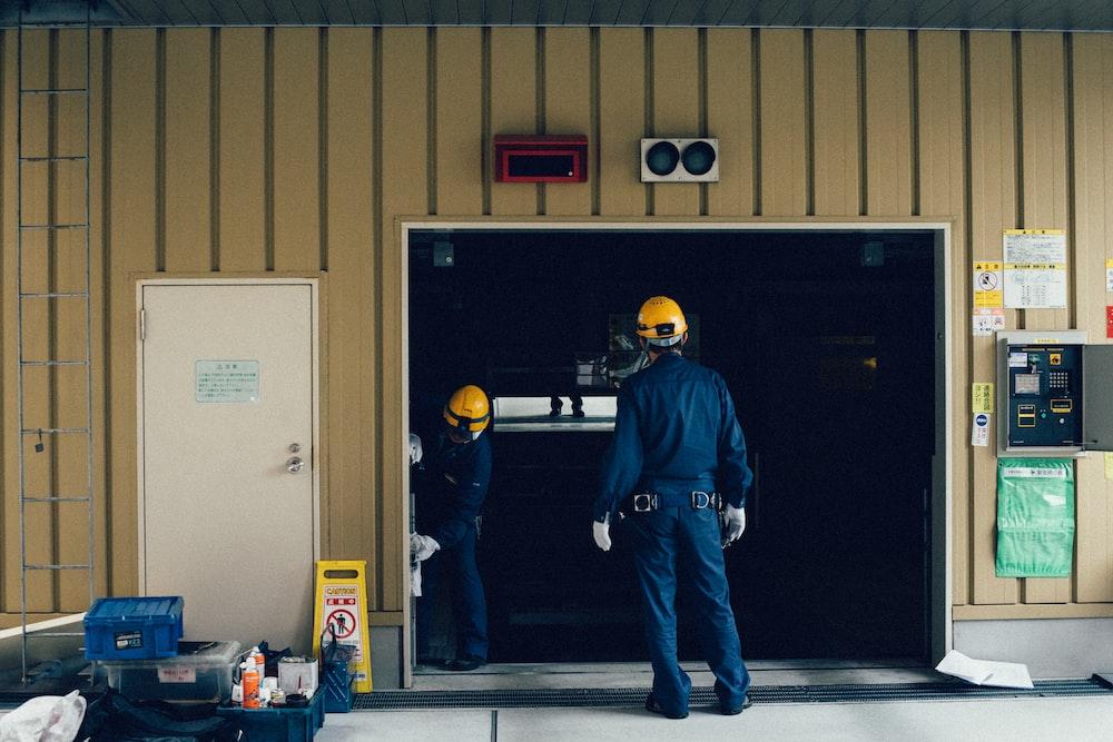man standing in front of open doorway