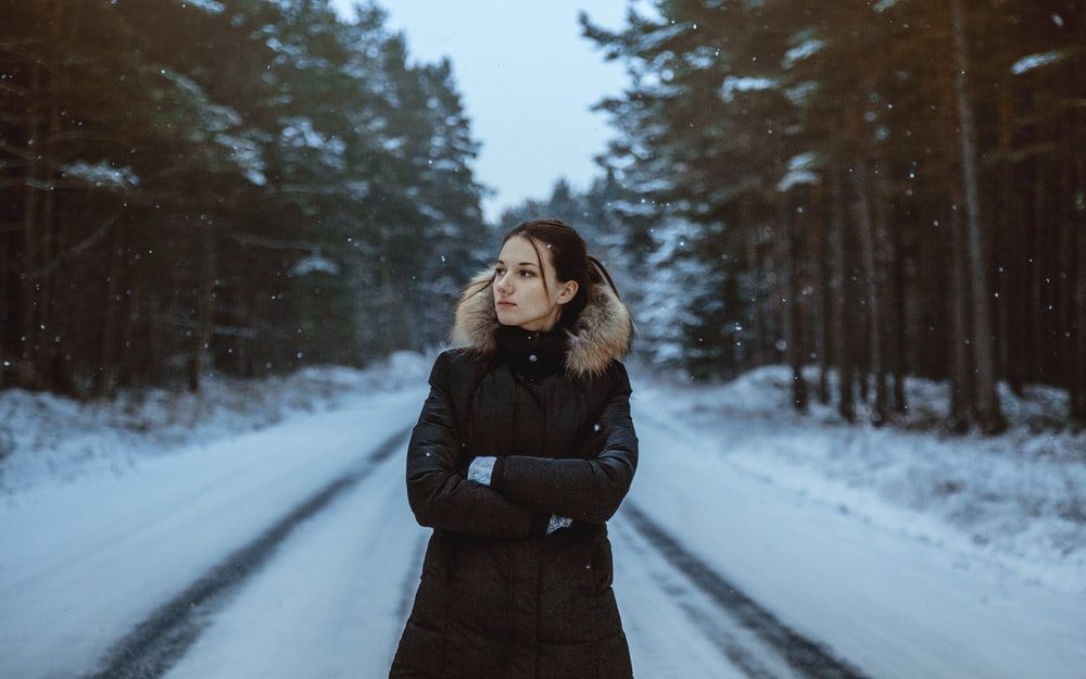 woman standing on snow field