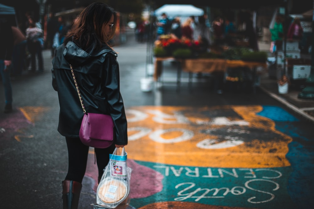 man holding groceries looking at her right side